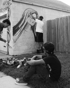 Young artists from #SWDetroit look on as @swfreddy shares his processes during a mural install. #Detroit. (c. 2014)