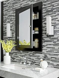 Storage-Packed Baths Behind Closed Doors-Recessed into the wall for a clean look, a medicine cabinet keeps creams and cosmetics out of sight, but convenient. The dark accent into the wall of tile breaks up the pattern, providing visual relief. Bathroom Mirror Storage, Bathroom Wall, Small Bathroom, Bathroom Ideas, Bathroom Vanities, Wooden Bathroom, Basement Bathroom, Glass Cabinet Doors, Mirror Cabinets
