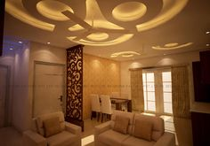 A plush modern sofa set in white completed the welcoming feel and modern appeal of the living room. The highlight though was the modern semi -circular design false ceiling with cove lighting. The mahogany finish and the differentiated false ceiling designs are carried out throughout the house.