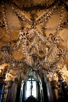 """The Church of All Saints, known as the """"Bone Church"""" in the Czech Republic. In 1511, skeletons were exhumed and used to decorate the chapel. This is too crazy not to see, if I am ever in Prague."""