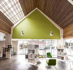 french studio bplusb architectures has extended the 'dainville library' with a pitched, barn roof addition.