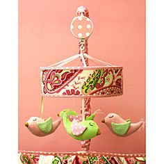 Keep your baby girl dreaming in peace with this adorable paisley and pink mobile.