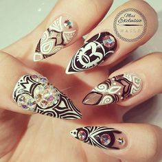 Disney nail art @missexclusivenails Mickey badass #Mickey inspiré par la belle et talentueuse @nailsup_  using @vetro_usa no.19 #gelpods  #mickeymouse #disney #disneyland #disneyworld #stilettonails #negativespacenails #nailart #nailsofig #nails #nails2inspire #nailstagram #nailsofinstagram #nailprodigy #nailpro #nailcouture #swarovskinails #hudabeautynails #instanails #mickeynails  #disneynails #blackandwhite#instarepost20