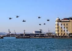 Nice helicopter formation over Volos Hellas on 25 March 2018 (creditQ https://www.facebook.com/134307283404765/photos/a.134310560071104.29372.134307283404765/928532883982197/?type=3)