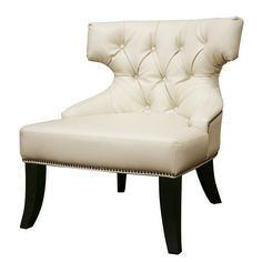 Button tufted cushions and a uniquely cut back support lend a charm to this off-white leather club chair that speaks for itself. It features an antiqued brass nail head trim and wooden legs.