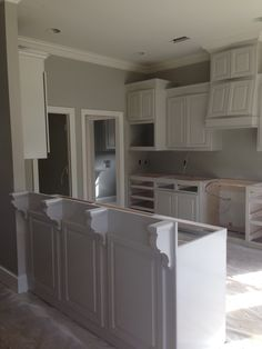 Walls are Benjamin Moore Revere Pewter. Cabinets are BM Edgecomb Gray. Trim is BM White Dove.