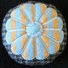 http://breitwerk.zibbet.com/pincushion-embroidered-wool-blue-orange