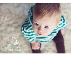 Classic overhead shot on this little 1 year old. Simple colors and simple lighting make it all about her! Photo by jonesyraephotography.com