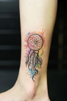 water color dreamcatcher tattoo. inked girl. small size tattoo More