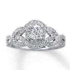 Found it. My dream engagement ring. Dreaming Big, I know. But if a certain someone needs help deciding, please refer him to this!