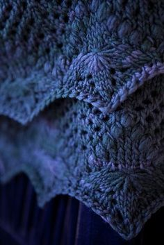 It might be the color, it might be the Estonian stitches, but this is beautiful Edited to add: and we have the Rav link to the project. It's an Echo Flower Shawl edging on a crescent shawl in worsted weight Malabrigo. Sweet!
