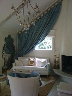 Slanted ceiling? Slanted drapes :] Cottage living room by Terri Pakravan of Decor Dose