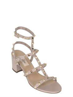 a7ec537172ab 60mm Leather covered heel . Adjustable buckle closures. Studded details .  Leather sole