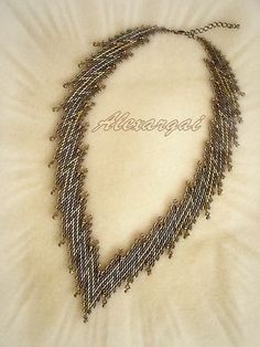 Zigzag Necklace by Alexargai, based on a  pattern in Bead & Button. Diagonal peyote stitch.