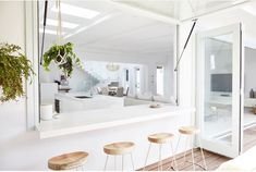 Kitchen Living Rooms Remodeling White indoor outdoor dining space with wide gas strut servery window Indoor Outdoor Kitchen, Outdoor Kitchen Design, Home Decor Kitchen, Kitchen Living, Kitchen Interior, Home Kitchens, Outdoor Dining, Kitchen Window Bar, Kitchen Cabinets