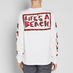 Immersed in the world of what we know as extreme sports, Life's a Beach was created to emulate the energy of surfing, skating and motocross legends. Emblazoned with loud prints and graphics throughout, the arms, chest and back have been decorated with a tiger patterned logo.  100% Cotton Ribbed Crewneck Tiger Pattern Chest & Back Print Life's a Beach Arm Print Woven Logo Tab
