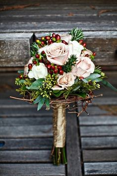 Perfect for a winter wedding, cranberries but with holly added in. Maybe navy coloured flowers    followpics.co