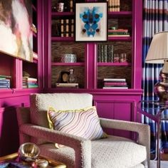 A bright and inviting reading area characterized by a berry color palette with blue accents. Click for full paint palette references!