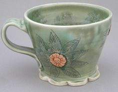 Green porcelain clay mug with orange accents | pottery