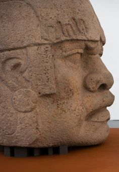 Intricately carved stone head of an Olmec