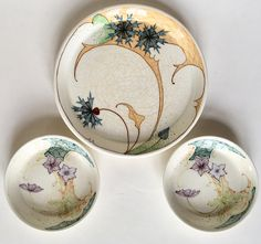 P-decor petit-fours set executed by Plateelbakkerij Zuid-Holland Gouda circa 1902-1905. Dutch Art Nouveau.