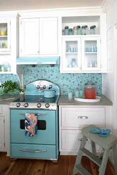 love the adorable blue stove in this kitchen