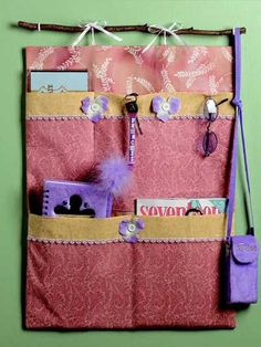 "This free sewing pattern makes a stylish wall hanging with pockets to hold her possessions. Finished wall hanging is 18"" x 24""."