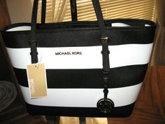 Cheap Michael Kors Jet Set Logo Large Brown Totes In Our Outlet Offers You High Quality And Unique Style!