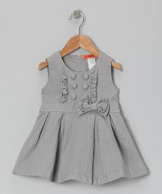 Flouncing all the fun of being young, this tunic touts a big bow at the waist plus pleated skirting. Factor in the easy zippered back, and this trendy little number is sure to please.100% polyesterMachine wash; tumble dryImported