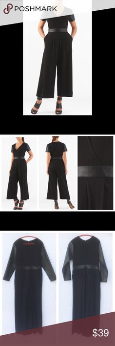 "New Eshakti Black Long Sleeve Jumpsuit XL 18 New Eshakti black knit jumpsuit w/ faux leather trim XL 18 Measured flat: Underarm to underarm:41 ½"" Waist:35 ½"" Inseam:28"" Sleeve:22 ½""  Eshakti size chart for XL 18 bust:43 ½"" Surplice v neck w/ inner snap, bodice darts to shape, back hidden zipper. Faux leather banded waist & sleeves (longer than 1st photos), single pleat through hips, side seam pockets. Cotton/spandex, jersey knit, light stretch, light structured feel, mid-weight, machine…"