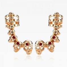 $6.95  Each of these ear wrap earrings features a cute ear cuff with a row of graduated rhinestone skulls.The Skull Ear Cuff Earrings are plated in plated gold and buffed to a brilliant luster.