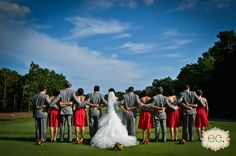 A fun bridal party picture with everyone's back turned, taken on our golf course!