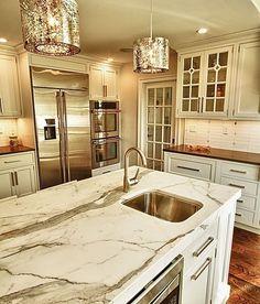 Glamorous White Kitchen with Elegant Hanging Lights