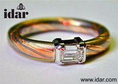 Idar - Mokume Gane, red and white gold, handmade in the idar workshop and set with a half carat emerald cut diamond.