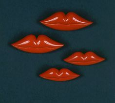 buttons designed by schiaparelli were inspired by mae west's lips....don't cha' think they would make lovely pins?