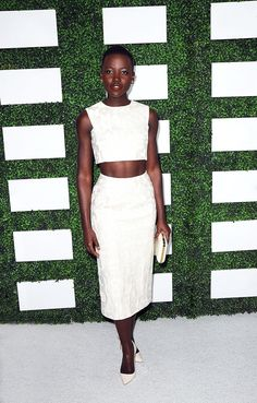 Lupita Nyong'o goes for a sophisticated take on the white crop in head to toe Giambattista  Valli paired with Sophia Webster pumps // #Actress #Style
