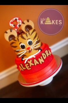Daniel Tiger Cake! Both tiers are iced in buttercream. Decorations and topper are Marshmallow Fondant.
