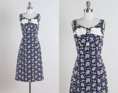 ➳ vintage 1950s dress    * black/white gingham print cotton  * cotton lining  * side bow w/woven ribbon  * detached belt  * metal back zipper    condition | excellent    fits like medium    length 46  bodice length 17  bust 38  waist 28    some clothes may be clipped on dress form to show best fit for appropriate size.    ➳ shop  http://www.etsy.com/shop/millstreetvintage?ref=si_shop    ➳ shop policies  http://www.etsy.com/shop/millstreet...
