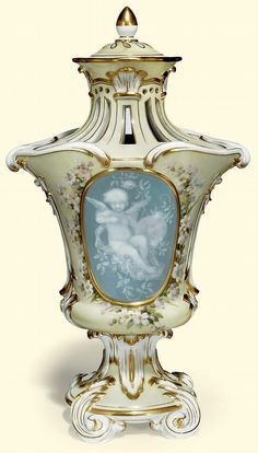 A MEISSEN PALE YELLOW GROUND PATE-SUR-PATE POT-POURRI VASE AND COVER <br />LATE 19TH CENTURY, BLUE CROSSED SWORDS MARK AND <i>PRESSNUMMER</i> 4/R62 <br />The front and back with a pale-blue oval panel decorated in white slip with a putto amongst flowers, within a raised gilt frame, reserved on a pale yellow ground painted with flowers, below a pierced shoulder and neck, the pierced cover with gilt acorn finial, on a circular foot moulded with four scroll feet<br />14¼ in. (36.2 cm.) high ...