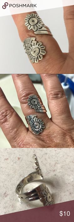 Sterling silver adjustable 2 flower ring This lovely sterling silver two flower adjustable ring can be worn on any finger. It is very comfortable and lovely. I received many compliments on this ring. Jewelry Rings