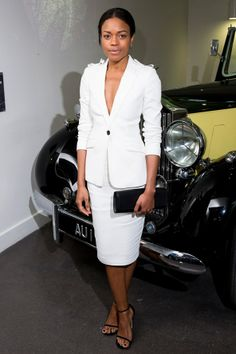 Naomie Harris wore a Burberry Tailoring white skirt suit, with a Smythson clutch to the Bond In Motion exhibition opening