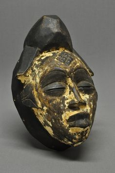 Africa | Punu mask from Gabon.  Carved wood with white pigment