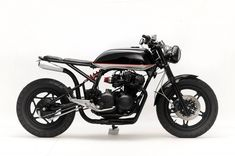"""Steel Bent Customs, based on a 1982 Honda CB750 and it's been dubbed """"The Convertible"""" due to the fact that you can remove that rear cowl, which then exposes an additional seat."""