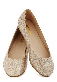 Unrivaled Radiance Flat, #ModCloth Each step in these sparkling gold flats makes a casually glam statement! Dazzled by all-over gold glitter, these round-toed, vegan faux-leather ballet flats are a twinkling treat for your toes. Step into their scalloped edges, paired with a teal A-line dress and a quilted purse, then go share your bright buoyancy with everybody!