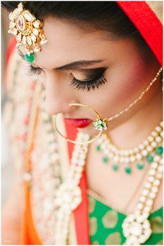 Toronto sikh wedding south asian Dixie Gurdwara Brampton baps swaminarayan temple photography  Indian bride hair and makeup, bridal portrait, indian bridal lehenga, red and green lehenga, indian nose ring, kundan jewellery