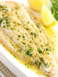 Foil-Baked Flounder - Flounder fillets are cooked in a foil packet with a butter sauce. Sealing the fish in the packet while cooking results in an extra flaky and tender dinner. Sole Fillet Recipes, Sole Recipes, Lemon Recipes, Fish Filet Recipes, New Recipes, Fish Dishes, Seafood Dishes, Seafood Recipes, Cooking Recipes