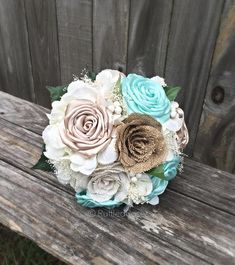 Tiffany blue/aqua and champagne roses paired with burlap roses, Baby's breath and artificial ivory hydrangeas.