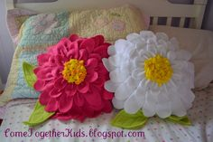 Flower pillows made of fleece - cute! Could be done in other fabrics depending where they are to be used.