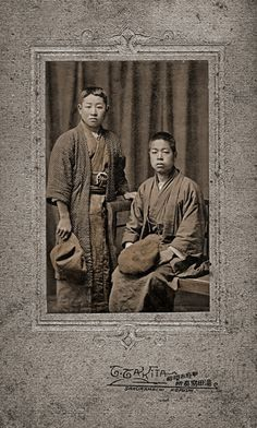 Portrait of two japanese schoolboys or students in traditional dress. 1910/1920. Made by G. Gakita.