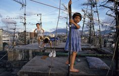 Children playing on Walled City rooftop, 1989 © Greg Girard